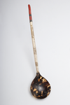 [Photo of a Tortoiseshell Spoon or Ladle with a             coral handle]